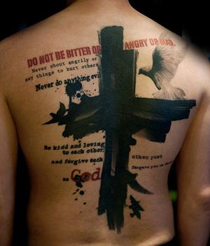 religious script tattoo