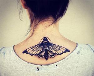 upper bcak neck tattoo