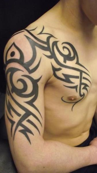 shoulder chest tribal tattoo by paul egan tattoo. Black Bedroom Furniture Sets. Home Design Ideas