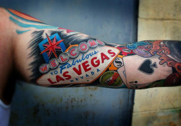 Arm gambling tattoo by little vinnies tattos for Vegas tattoo shops