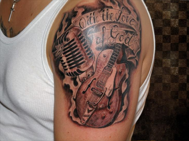 Shoulder realistic guitar tattoo by andys body electric for Flesh electric tattoo