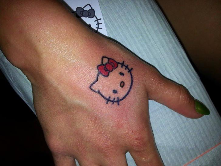 Hand Hello Kitty Tattoo By Shogun Tats
