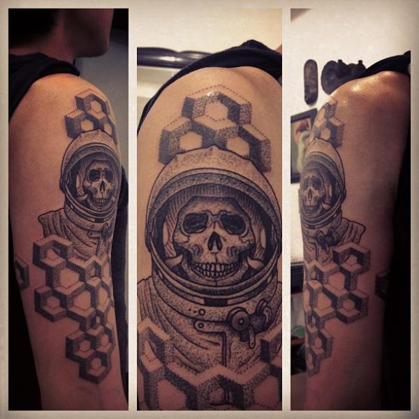 Arm dotwork astronaut tattoo by gregorio marangoni