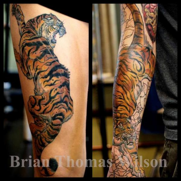 Arm tiger thigh tattoo by scapegoat tattoo for Tiger thigh tattoos