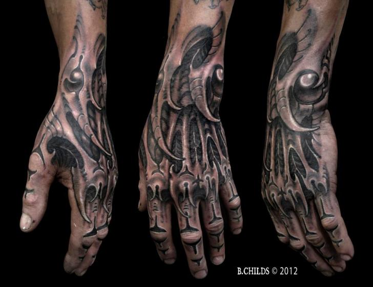 biomechanical hand tattoo by spider monkey tattoos