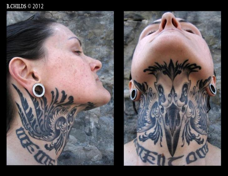 neck chin tattoo by spider monkey tattoos
