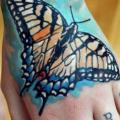 Hand Butterfly tattoo by Otzi Tattoos