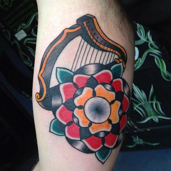 Arm Old School Flower Harp Tattoo by North Side Tattooz