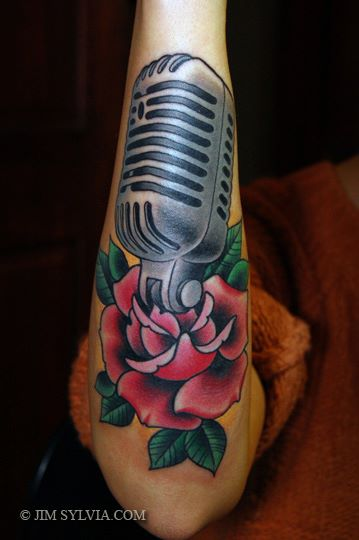 Arm microphone tattoo by jim sylvia for Jim sylvia unbreakable tattoo