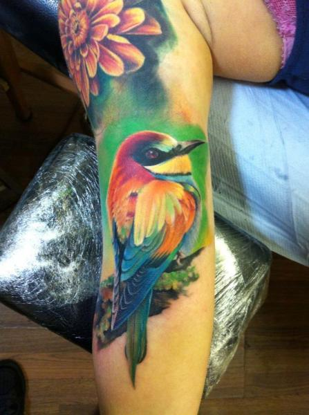 Arm realistic bird tattoo by restless soul tattoo for Realistic bird tattoo