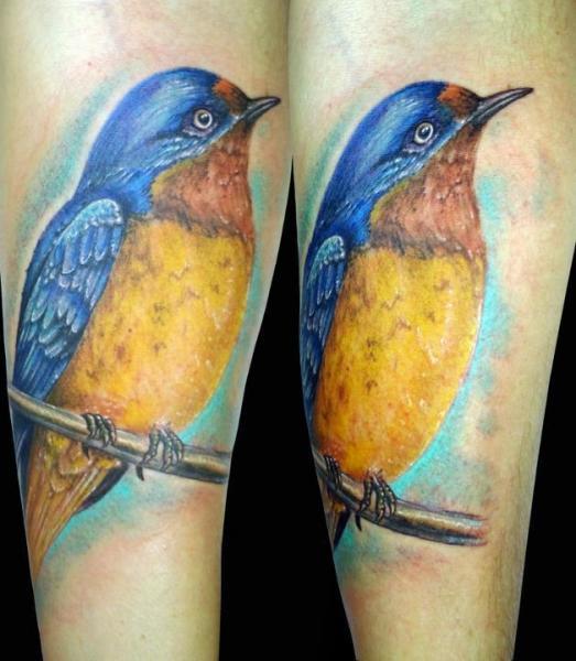 Arm realistic bird tattoo by insight studios for Realistic bird tattoo
