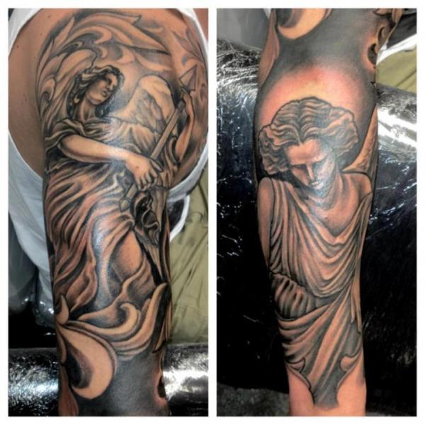 Arm fantasy angel tattoo by border line tattoos for Line tattoos on arm