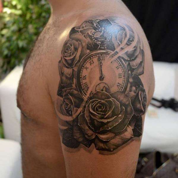 Shoulder realistic clock flower tattoo by elvin tattoo
