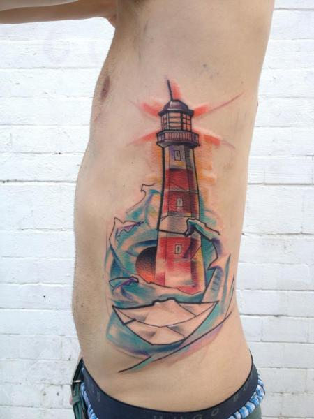 Lighthouse side tattoo by voller konstrat