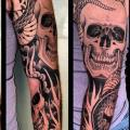 Snake Skull Sleeve tattoo by Three Kings Tattoo