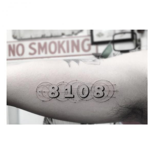 Arm lettering tattoo by dr woo for Dr woo tattoo price