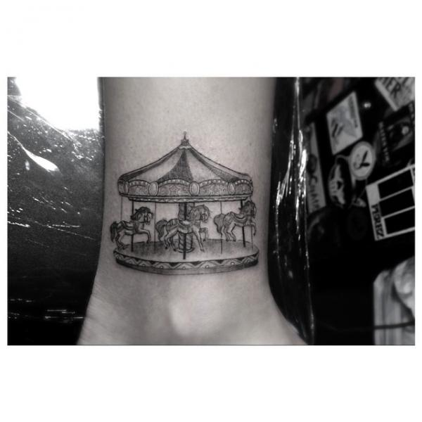 Arm carousel tattoo by dr woo for Dr woo tattoo price