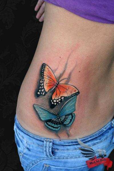 Realistic Side Butterfly Tattoo by Black Ink Studio