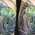 Arm Fish tattoo by Twisted Anchor Tattoo