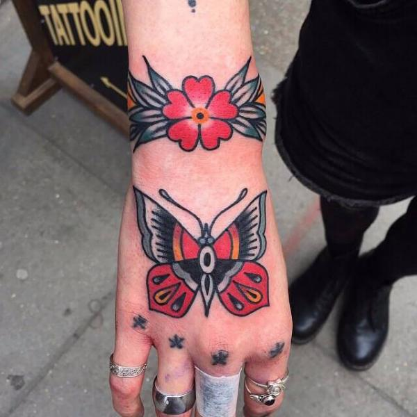 Old School Hand Butterfly Tattoo by Cloak and Dagger Tattoo