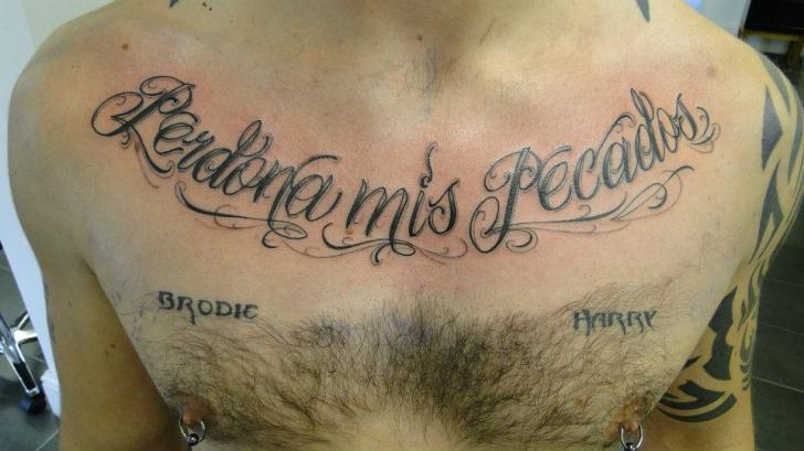 Chest Lettering Tattoo by Evolution Tattoo