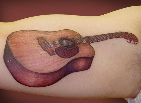 Arm Realistic Guitar Tattoo by Adrenaline Vancity