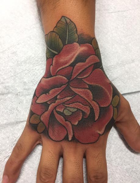 Flower Hand Tattoo by Adrenaline Vancity