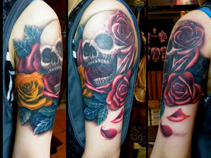 Shoulder Skull Flowers Tattoo by Orient Soul