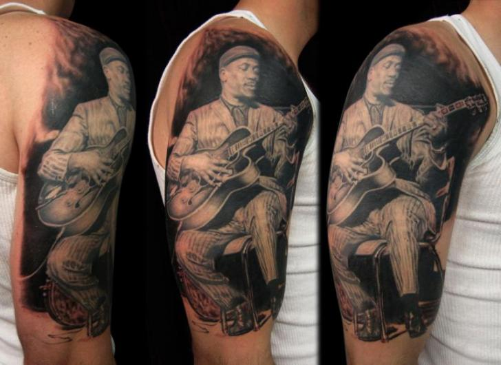 Shoulder Portrait Realistic Guitar Tattoo by Apocalypse Tattoo