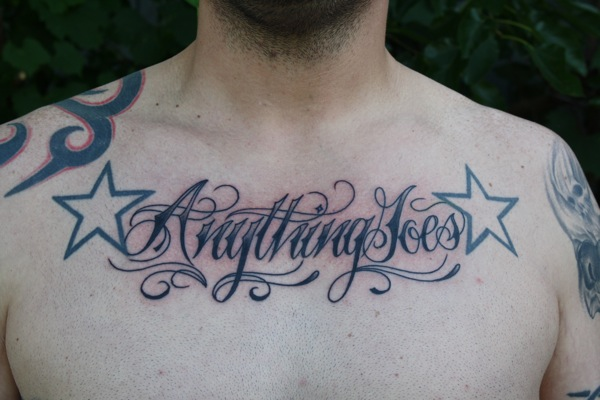 Chest Lettering Tattoo by Bugaboo Tattoo