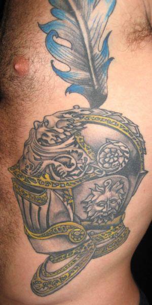 Seite Masken Tattoo von Deluxe Tattoo