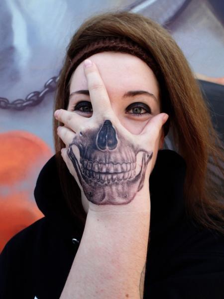 Skull Hand Tattoo by Bloody Blue Tattoo