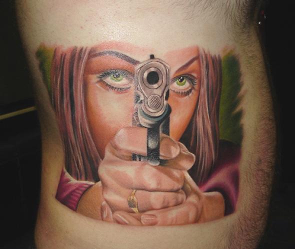 Realistic Side Women Gun Tattoo by Bloody Blue Tattoo