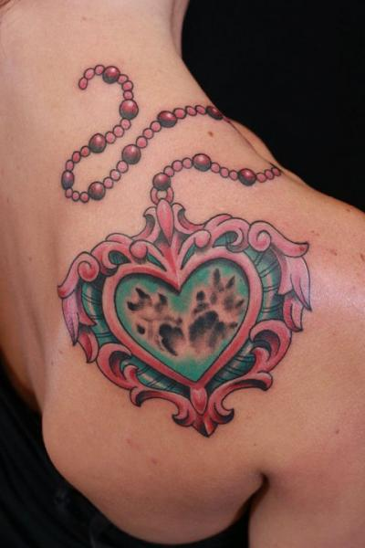 Shoulder Heart Medallion Tattoo by Gold Rush Tattoo