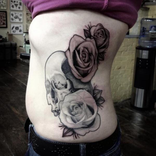 Flower Side Skull Tattoo by Graceland Tattoo