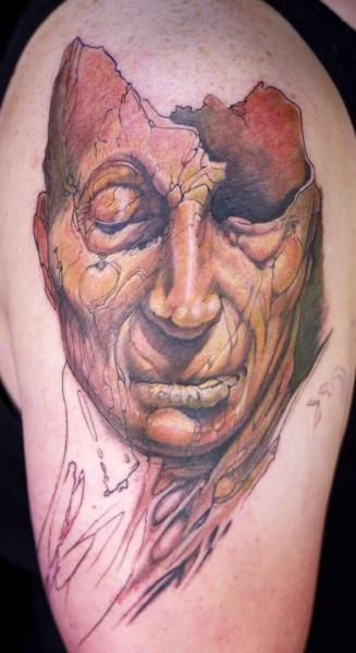 Shoulder Mask Tattoo by Graven Image Tattoo