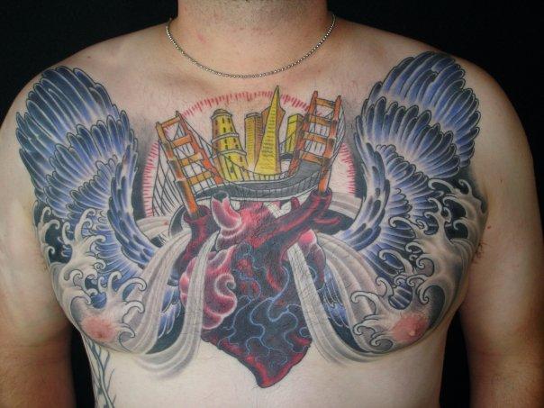 Chest Heart Wings Tattoo by Guru Tattoo