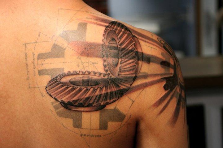 Shoulder Gear Tattoo by Guru Tattoo