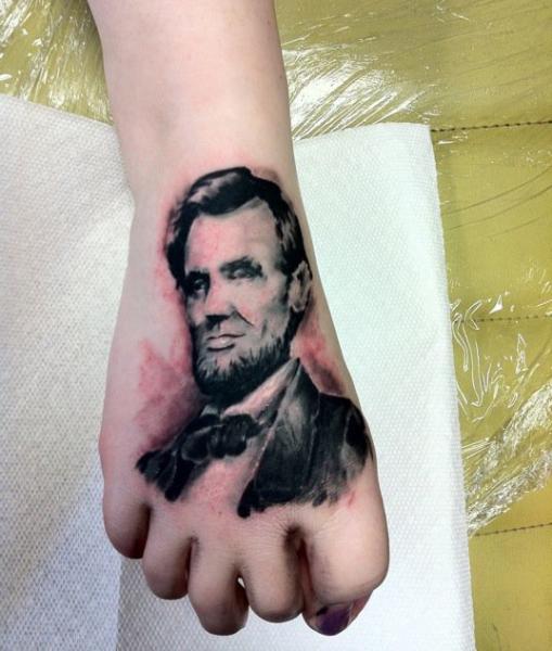 Portrait Realistic Hand Lincoln Tattoo by High Street Tattoo