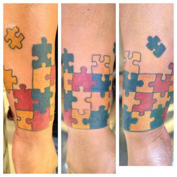 Arm Puzzle Tattoo by Inkd Chronicles