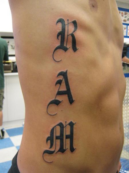 Side Lettering Tattoo by Inxon Tattoo