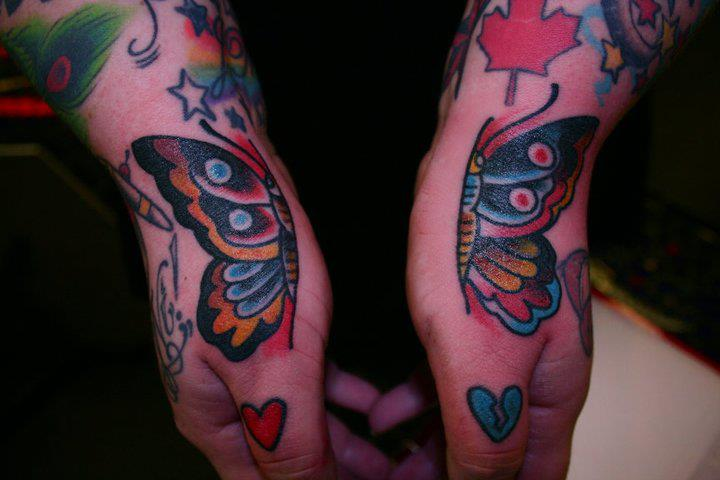 Old School Hand Butterfly Tattoo by Iron Age Tattoo