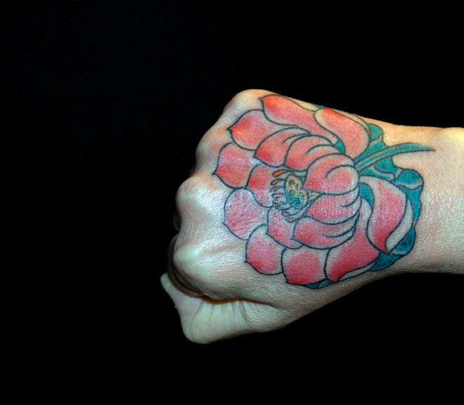 Flower Hand Tattoo by JP Rodrigues