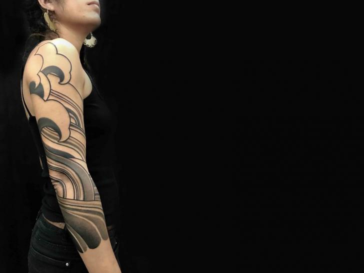 Arm Wave Tattoo by Belly Button Tattoo Shop