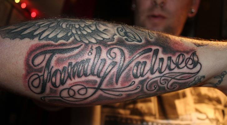 Arm Lettering Tattoo by Lone Wolf Tattoo