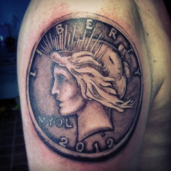 Shoulder Coin Tattoo by Memorial Tattoo