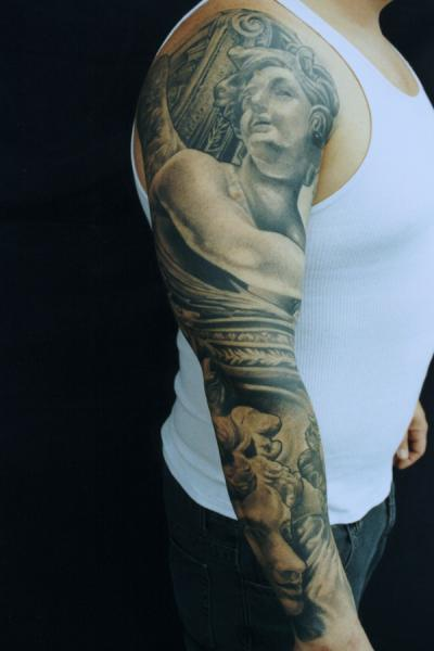 Arm Realistic Statue Tattoo by Monte Tattoo
