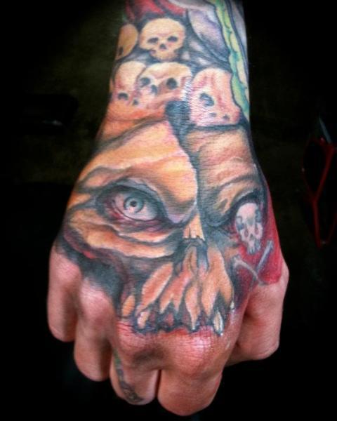 Skull Hand Tattoo by Nightmare Studio