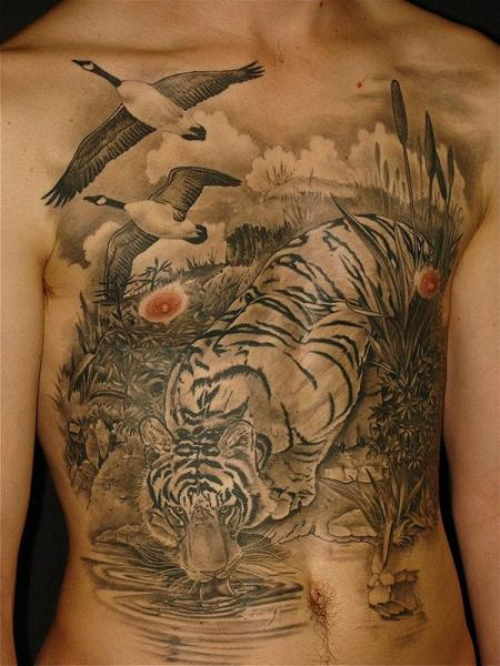 Realistic Chest Tiger Belly Bird Tattoo by Ethno Tattoo