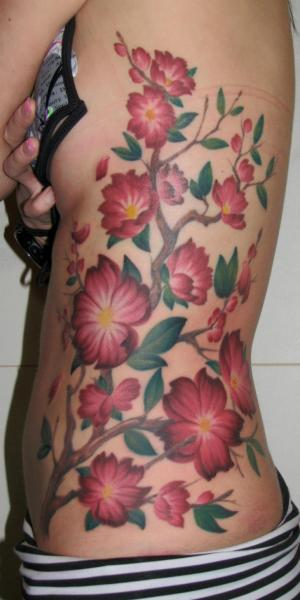 Realistic Flower Side Tattoo by Optic Nerve Arts